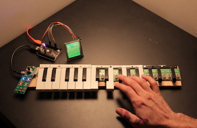 'yay brain', a deconstructed midi keyboard connected to a small LCD screen, installed at the 2018 SFPC spring student showcase.